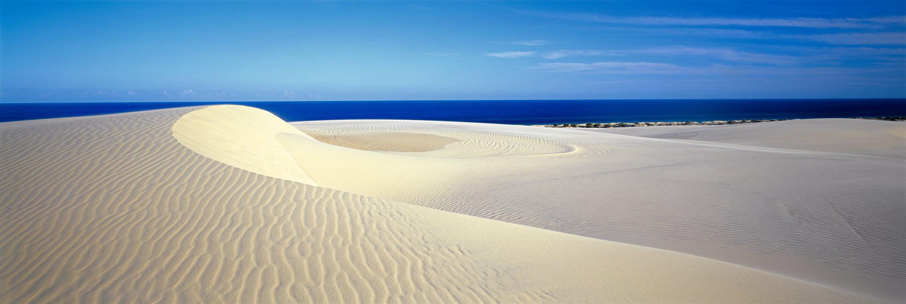 Beige sand dunes along the coast of Fraser Island National Park Australia