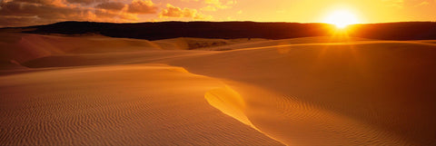 Sun shining over the golden sand dunes of Fraser Island Australia
