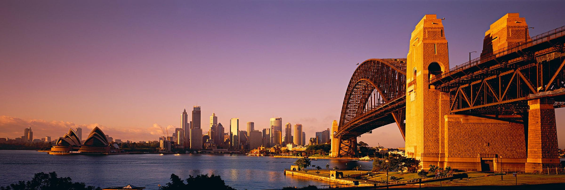 Sydney Harbour Bridge at sunrise with The Opera and city of Sydney Australia in the background