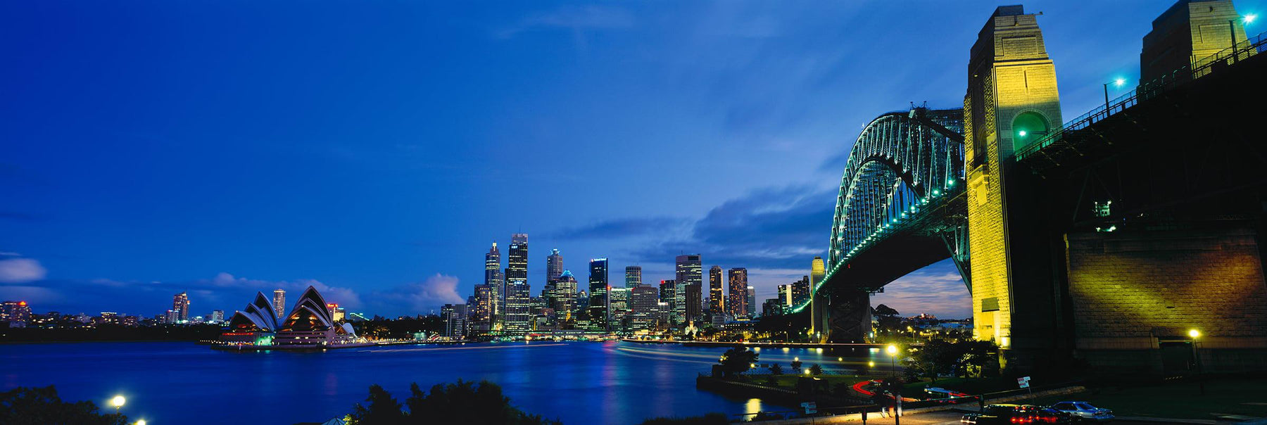 Sydney Harbour Bridge at twilight with The Opera and city of Sydney Australia in the background