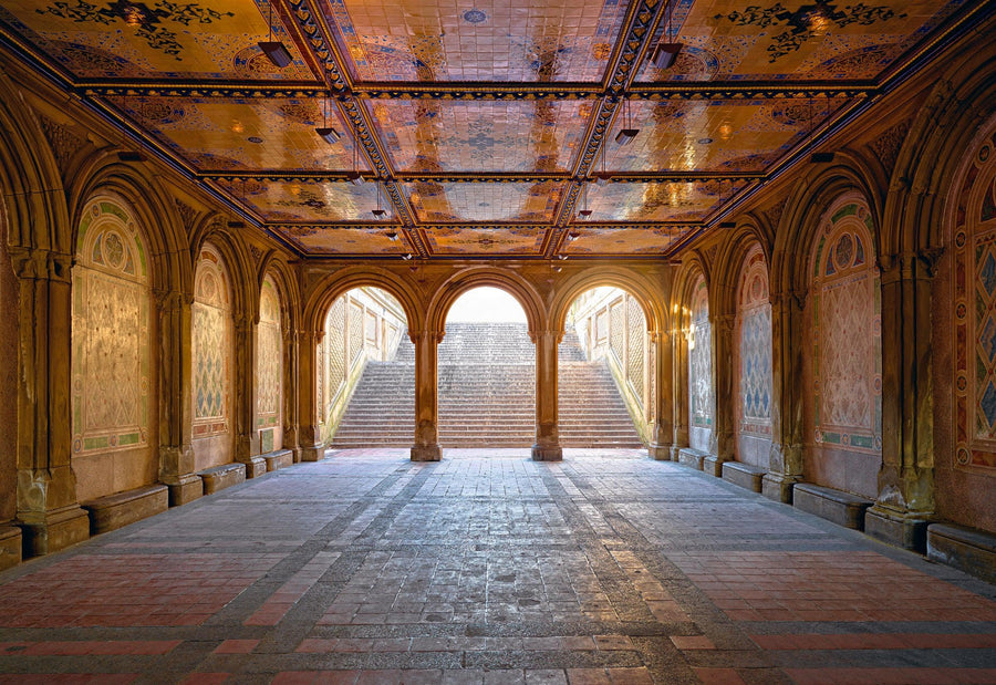 Underground walkway with gold ceilings and arch corridors leading up stairs to Central Park New York