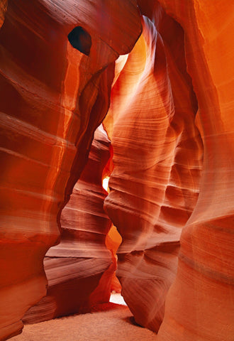 Sand path through the red sandstone walls of the slot canyons in Antelope Canyon Arizona