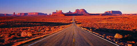 Looking straight down Highway 163 running into the sandstone buttes of Monument Valley Utah