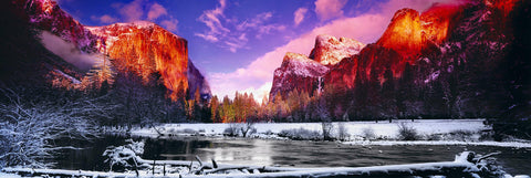 River running through the snow covered Yosemite Valley with El Capitan mountain in the background