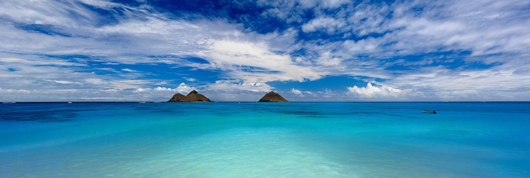 Bright turquoise ocean and two small islands off the coast of Lanikai Hawaii
