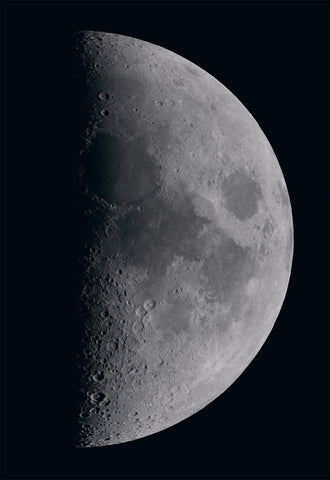 Close up of the right side of the moon during a half moon lunar phase