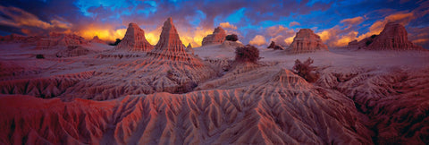 Sculptured towers of dirt in the remote outback in Mungo National Park Australia at sunset