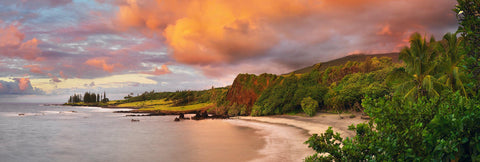 Clouds rolling over a tropical cove and beach in Maui Hawaii during sunset
