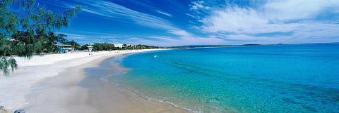 White sand beaches and turquoise ocean at Main Beach Australia at mid day