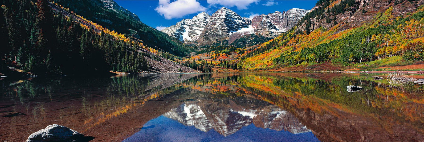 Maroon Lake reflecting the Autumn forest and two snow covered peaks of Maroon Bells Colorado