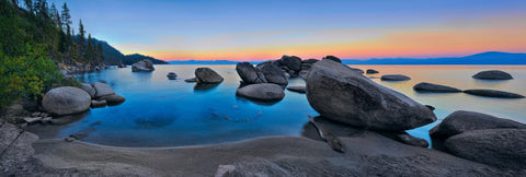 Boulders in a cove and along the shore of Lake Tahoe California at sunset