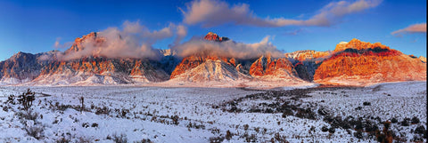 Clouds in front of the snow covered mountains and desert of Red Rock Canyon Nevada