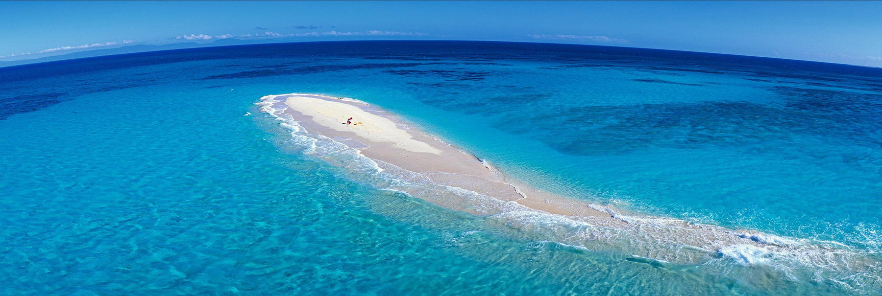 Aerial view of the sandy beach of Upolu Cay surrounded by the turquoise ocean at the Great Barrier Reef Australia