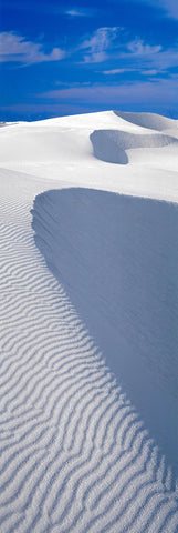 Windswept sand dunes with blue skies in the White Sand Dunes National Monument New Mexico
