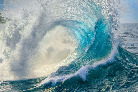 Turquoise wave rolling and crashing into the ocean water in Maui Hawaii