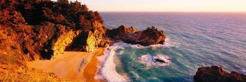 McWay Falls dropping off a cliff to the sandy beach at Julia Pfeiffer Burns State Park California