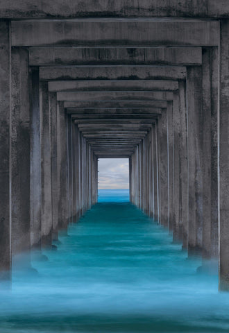 Zoomed in view off the turquoise waves crashing under Scripps Pier in La Jolla California