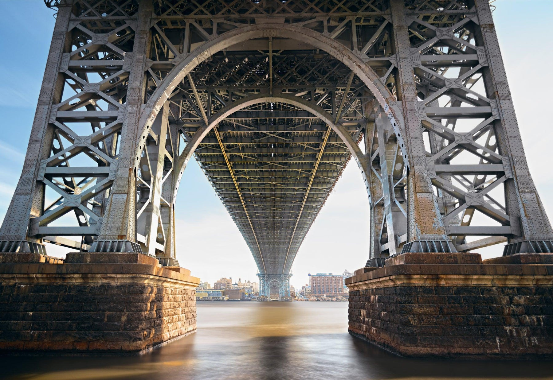 View from under the Williamsburg Bridge with the city of New York in the background