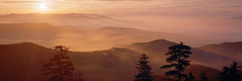 Sun setting over the misty mountain tops of the Great Smoky Mountains National Park Tennessee