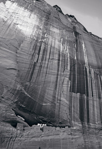 Black and white stone city carved out of the cliff face in Canyon de Chelly Arizona