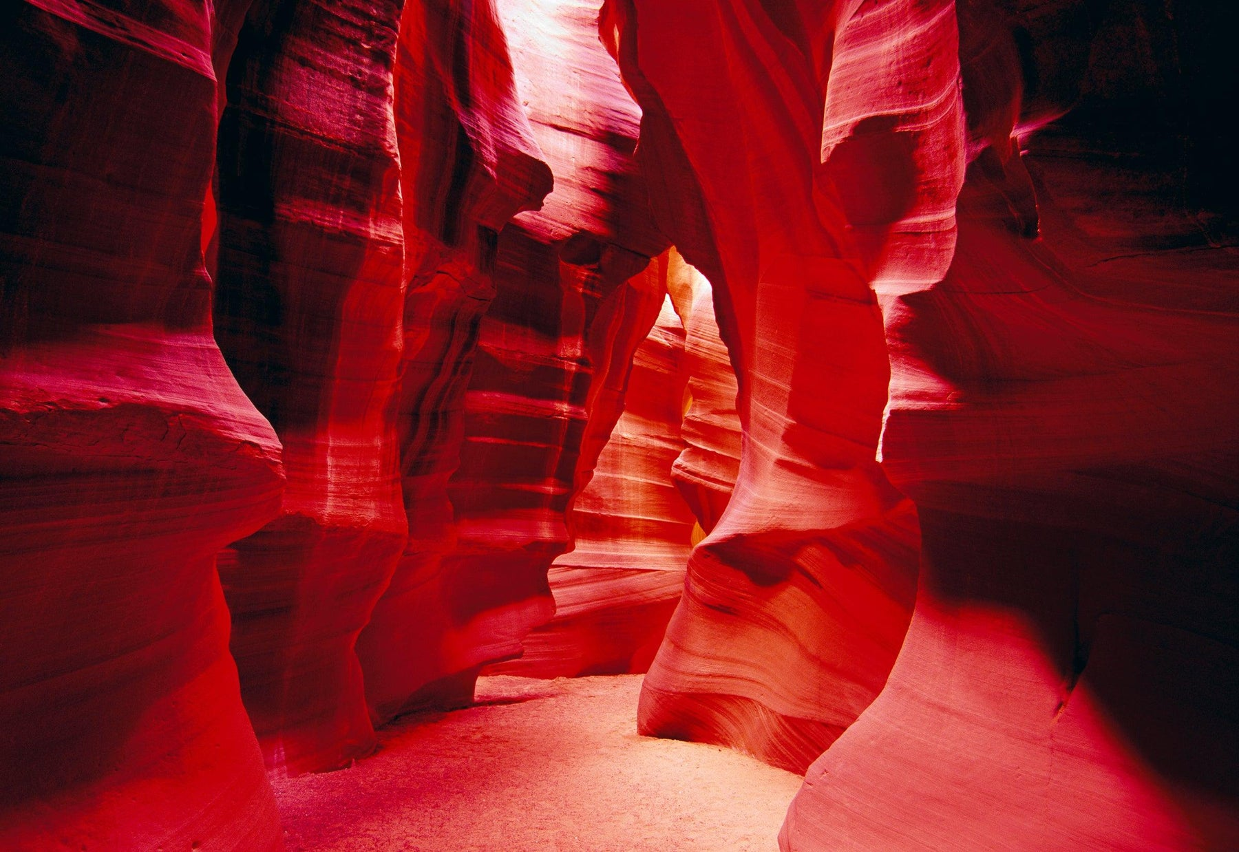 Sand walkway inside the red sandstone slot canyons of Antelope Canyon Arizona