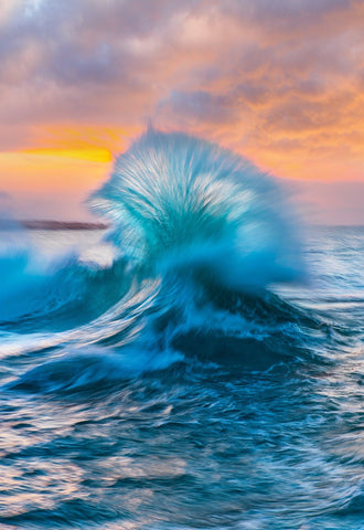 Two turquoise waves crashing into each other in the ocean of the coast of Kapalua Hawaii