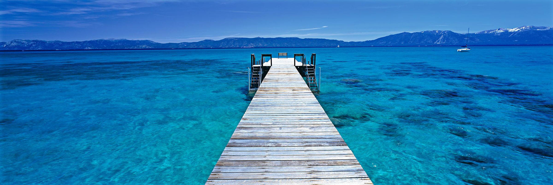 White wooden jetty stretching over the turquoise waters of Lake Tahoe California