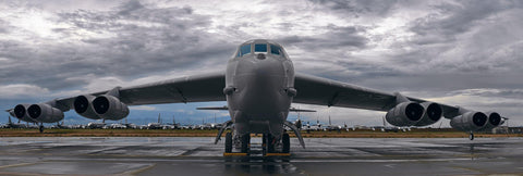 B-52 Bomber airplane on the runway in Tucson Arizona with clouds covering the sky above