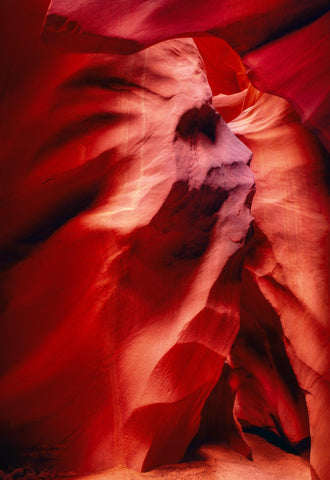 Face like formation carved out of the red sandstone walls of the slot canyons in Antelope Canyon Arizona