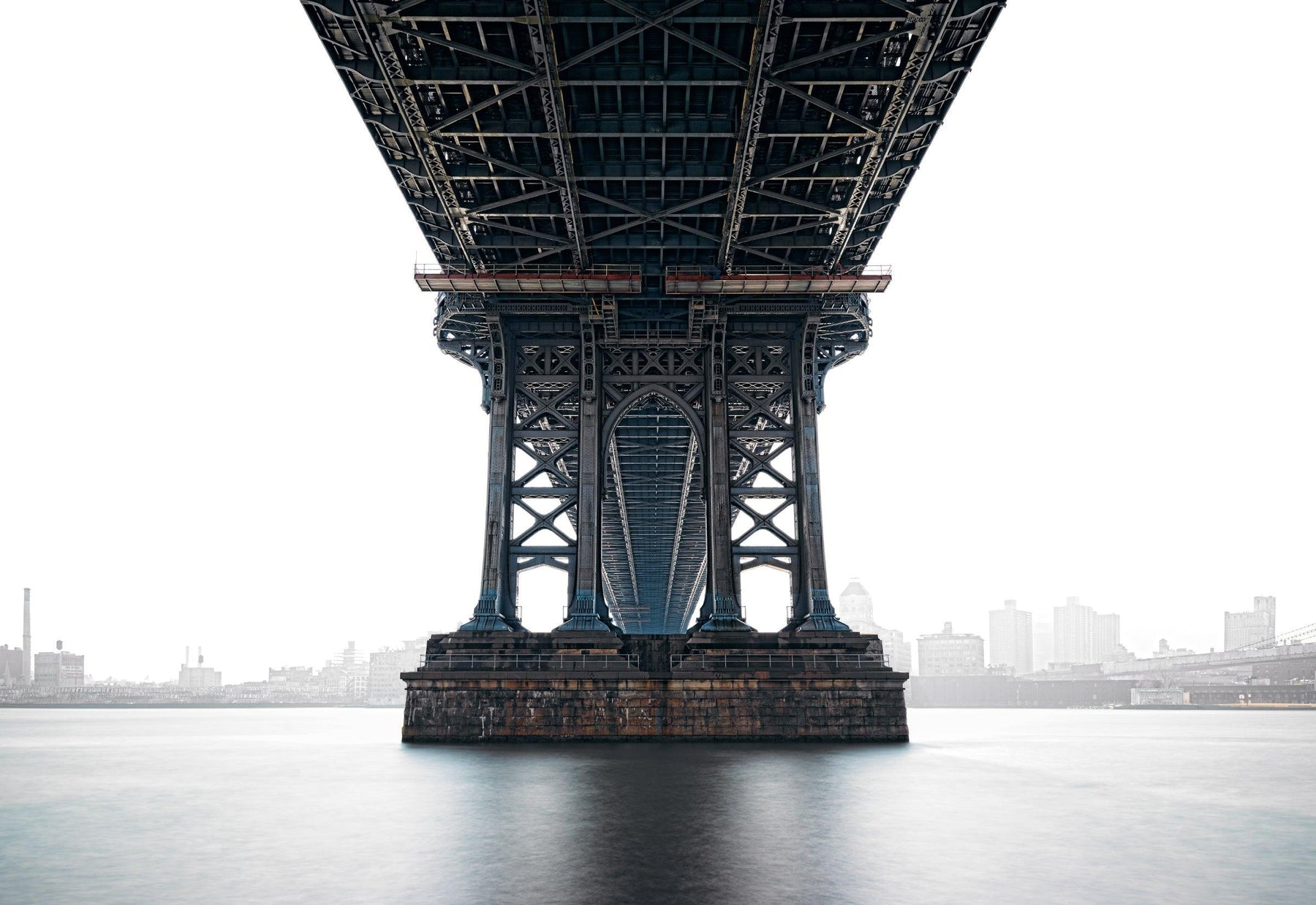 View from under the Manhattan Bridge with the city of New York overexposed in the background