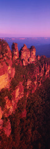 Formation of rocky cliffs covered with trees in the Blue Mountains of New South Wales