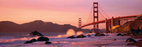 Waves crashing on the rocks of Baker Beach California with the Golden Gate Bridge in the background