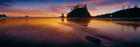 Silhouettes of the rock sea stacks and shoreline along Second Beach Washington at sunset