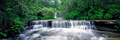 Waterfalls pouring down the rocky river in Blue Mountains National Park, Australia