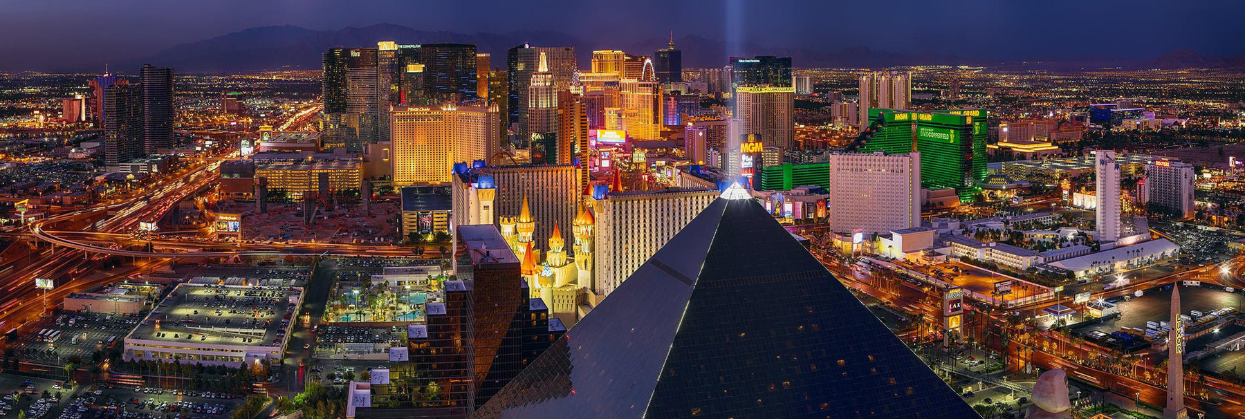 Rooftop view of the Las Vegas strip with the light of the Luxor hotel shining into the sky