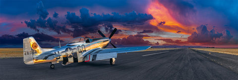 P51 Mustang airplane sitting on a runway in Aurora Oregon looking out at a cloud filled sky at sunset