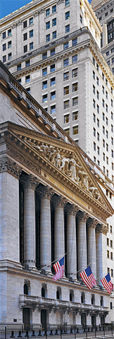 Stone pillars and architectural carvings on the exterior of a building on Wall Street New York