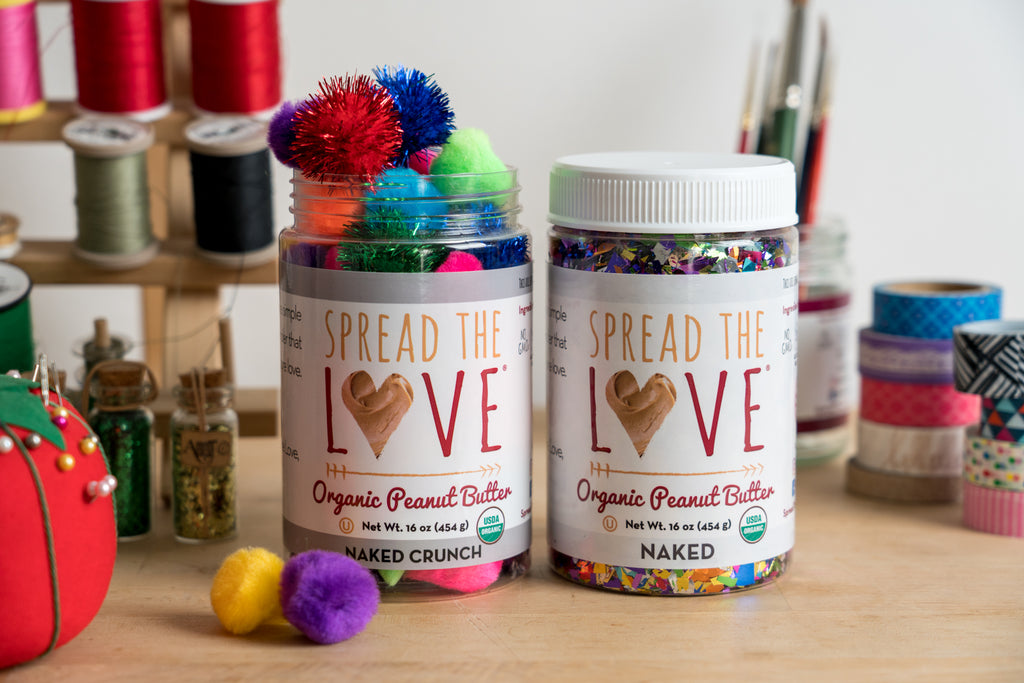 Spread The Love jars used to hold crafting supplies