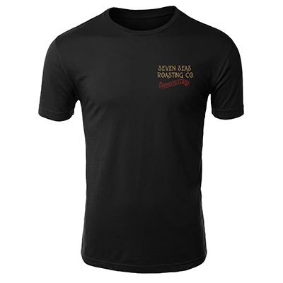 Front of Black t-shirt with keeper of the flame art work in red and gold and seven seas roasting written on top left