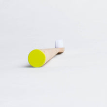 Load image into Gallery viewer, Replace your plastic toothbrush with a MABLE bamboo toothbrush. The handle is made from sustainably harvested bamboo, certified by the FSC and is fully compostable. This MABLE brush has a unique self-standing design and can be stored in your medicine cabinet or counter top.