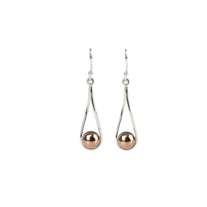 Mixed metal drop earring with a copper ball caught in a silver loop Antonia Scales jewellery