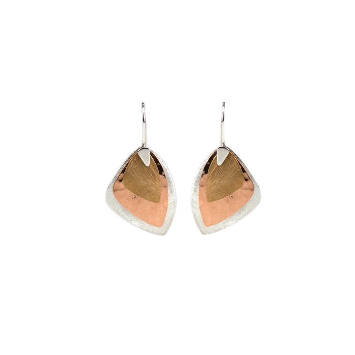 Earring with three layers of contrasting colours; silver, copper and brass, each with a different finish - scratched, hammered and brushed Antonia Scales jewellery