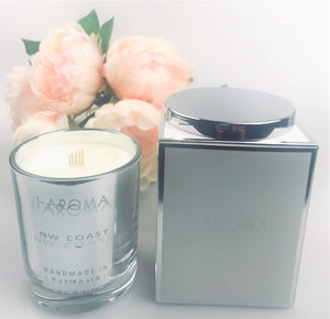 i-Aroma's NW Coast Luxury Candle is our signature scent representing the fresh, clean & uplifting scent of the north-west coast of Tasmania during the summer.  An aromatic blend of fresh citrus and the herbaceous freshness of lavender combined with a bouquet of crisp white flowers and warm woodland base, this candle is loved by men and women like.