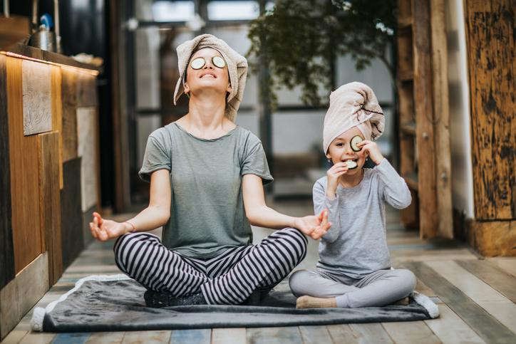 mother and child doing yoga to boost immunity