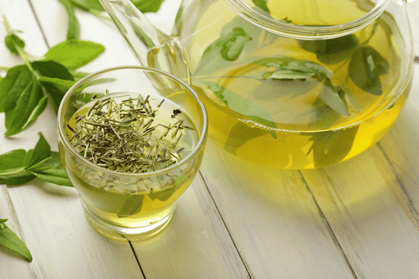 green tea with tea leaves