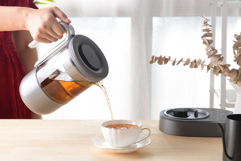 automatic tea maker pouring tea