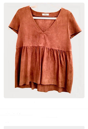 orangish brown shirt