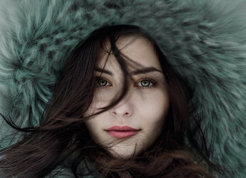 Close up image of a girl wearing fur.
