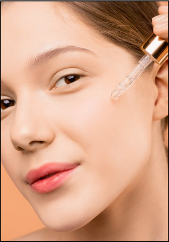 woman with pink lips applying oil