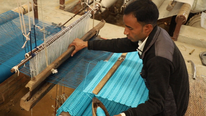 Man in India hand weaving yoga mat Ritual Rug Turquoise